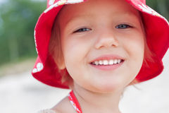Cheerful child girl smiling face. Close up outdoor Royalty Free Stock Photo