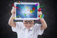 Cheerful child holds tablet with formula Stock Image