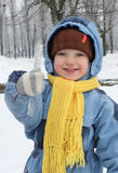 Cheerful Child Keeps Icicle Stock Image