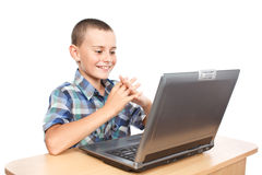 Cheerful child at laptop Royalty Free Stock Photos