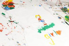 Cheerful child painting on a t-shirt. Close up Royalty Free Stock Photos