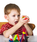 Cheerful child with plasticine Royalty Free Stock Photo
