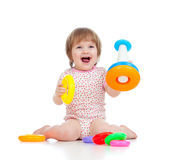 Cheerful child playing with colorful toy Royalty Free Stock Photography