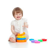 Cheerful child playing with colorful toy Royalty Free Stock Images