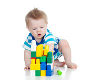 Cheerful child playing with construction set royalty free stock photography
