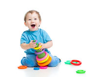 Cheerful child playing with educational toy Royalty Free Stock Images