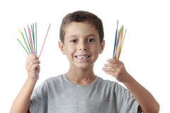 Cheerful child playing mikado Stock Images