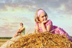 Cheerful child on straw rolls. royalty free stock photos