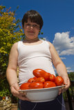 Cheerful child with tomatoes Royalty Free Stock Photography