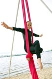 Cheerful child training on aerial silks Royalty Free Stock Image
