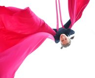Cheerful child training on aerial silks Royalty Free Stock Images