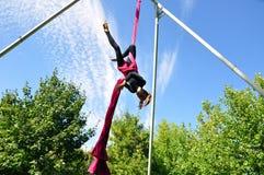 Cheerful child training on aerial silks Stock Photos