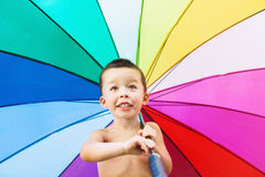 Cheerful child turning big colorful umbrella Stock Photography