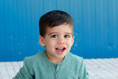 Cheerful child with two years on the street Stock Photos