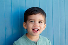 Cheerful child with two years on the street Royalty Free Stock Photos