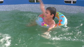 Cheerful children bathe in pool in summer  day stock video footage