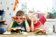 Merry Breakfast sandwiches .Breakfast. Cheerful children at Breakfast . Brother and sister with sandwiches stock image