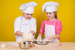 Cheerful children cook pizza Stock Photo