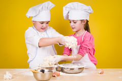 Cheerful children cook pizza Royalty Free Stock Image