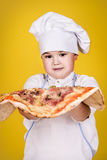 Cheerful children cook pizza Stock Photography