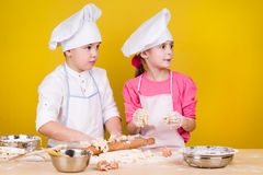 Cheerful children cook pizza Stock Photos