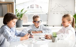 Cheerful children are earning money Stock Photos