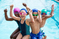 Cheerful children enjoying at poolside Stock Images