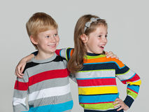 Cheerful children on the grey background Royalty Free Stock Photography