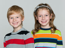 Cheerful children on the grey background Stock Images