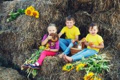 Cheerful children have Breakfast outdoors Stock Photos