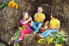 Cheerful children have Breakfast outdoors Stock Image