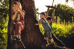Cheerful children having fun outdoors in forest during summer holidays in countryside symbolizing happy carefree childhood stock image
