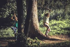 Cheerful children having fun outdoors woods during summer holidays in countryside symbolizing happy carefree childhood. Cheerful children having fun outdoors Stock Image
