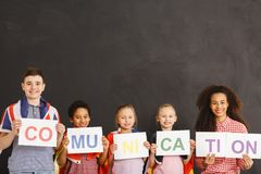 Cheerful children holding communication inscription. Together Royalty Free Stock Photos