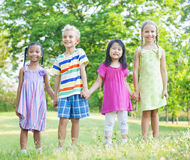 Cheerful Children Holding Hands in the Park Stock Images