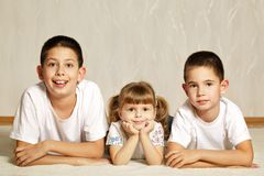 Cheerful children lying on floor Royalty Free Stock Photos