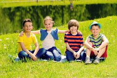 Cheerful children in park royalty free stock photography