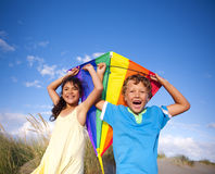 Cheerful Children Playing Kite Outdoors Stock Photo
