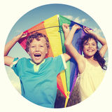 Cheerful Children Playing Kite Outdoors Concept Royalty Free Stock Image