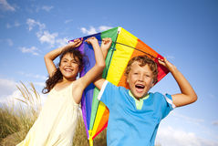 Cheerful Children Playing Kite Outdoors Concept Stock Photos