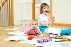 Cheerful children plays in home Royalty Free Stock Photo
