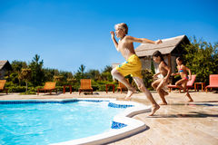 Cheerful children rejoicing, jumping, swimming in pool. Copy space Royalty Free Stock Image
