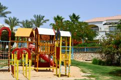 Cheerful children`s playground with slides sand puddles playing games and designs an exotic tropical warm country holiday resort royalty free stock photography