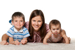 Cheerful children with smiling mother Stock Images