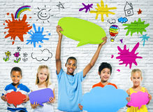 Cheerful Children With Speech Bubbles Royalty Free Stock Photos
