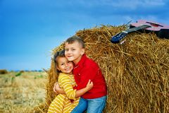 Cheerful children on a summer walk in the field. Beautiful brother and sister . Children in bright clothes stock images