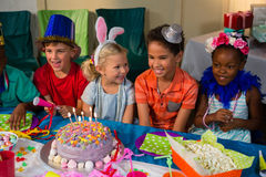 Cheerful children at table Stock Images