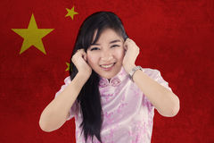 Cheerful Chinese girl with flag of China Royalty Free Stock Photo