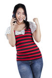 Cheerful chinese girl talking on the phone Stock Image