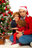 Cheerful Christmas family Stock Photos